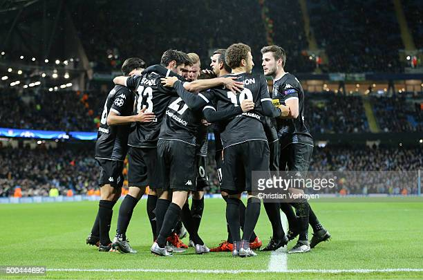 The Team of Borussia Moenchengladbach celebrate after their first goal during the UEFA Champions League group D match between Manchester City FC and...