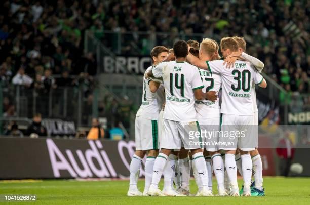 The Team of Borussia Moenchengladbach celebrate during the Bundesliga match between Borussia Moenchengladbach and Eintracht Frankfurt at...
