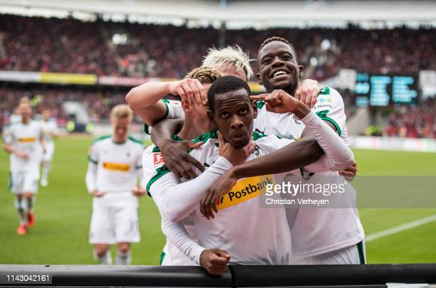 The Team of Borussia Moenchengladbach celebrate their teams third goal during the Bundesliga match between 1.FC Nuernberg and Borussia...