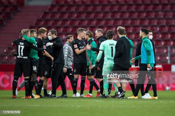 The Team of Borussia Moenchengladbach celebrate their victory after the Bundesliga match between 1. FSV Mainz 05 and Borussia Moenchengladbach at...