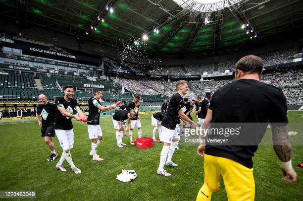 MOENCHENGLADBACH GERMANY JUNE The Team of Borussia Moenchengladbach celebrate their win and Qualification for the Champions League after the...