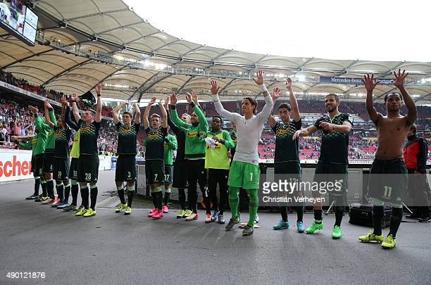 The Team of Borussia Moenchengladbach celebrate with their fans after the Bundesliga match between VfB Stuttgart and Borussia Moenchengladbach at...
