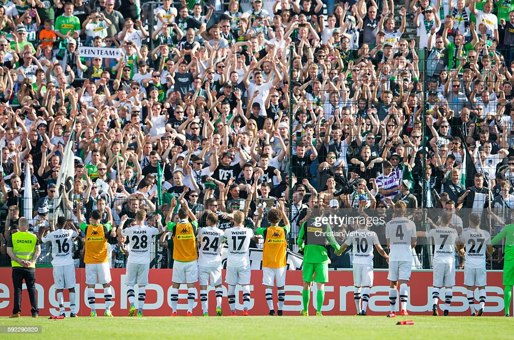 The Team of Borussia Moenchengladbach celebrate with their fans after the DFB Cup match between SV Drochtersen/Assel and Borussia Moenchengladbach at Kehdinger Stadion on August 20, 2016 in Drochtersen, Germany.