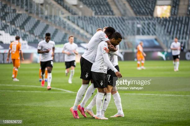 The Team of Borussia Moenchengladbach celebrates after Alassane Plea scored his teams fifth goal during the Bundesliga match between Borussia...