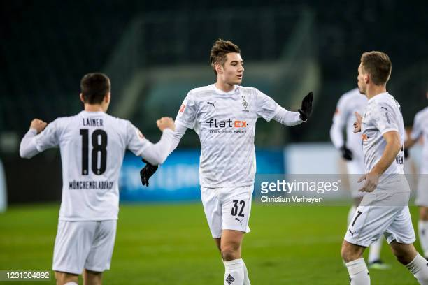The Team of Borussia Moenchengladbach celebrates after Florian Neuhaus scored his teams first goal during the Bundesliga match between Borussia...