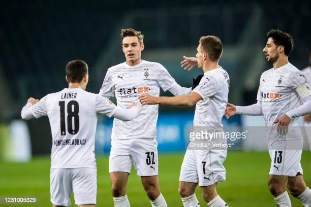 The Team of Borussia Moenchengladbach celebrates after Florian Neuhaus scored his teams first goal during the Bundesliga match between Borussia...