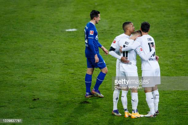 The Team of Borussia Moenchengladbach celebrates after Hannes Wolf scored his teams fourth goal during the Bundesliga match between Borussia...
