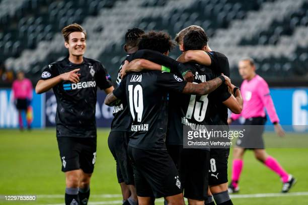 The Team of Borussia Moenchengladbach celebrates after Lars Stindl scored his teams first goal during the Group B UEFA Champions League match between...