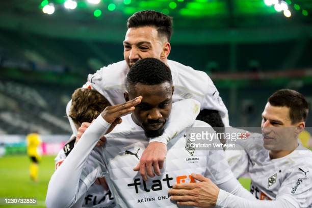 The Team of Borussia Moenchengladbach celebrates after Marcus Thuram scored his teams fourth goal during the Bundesliga match between Borussia...