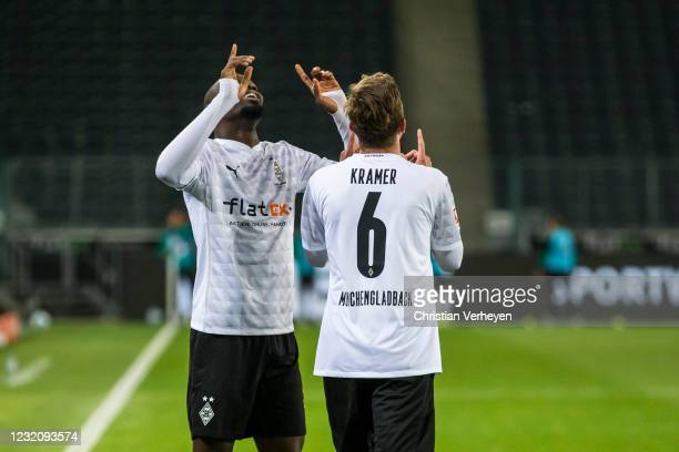 The Team of Borussia Moenchengladbach celebrates after Marcus Thuram scored his teams second goal during the Bundesliga match between Borussia...