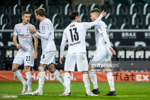 The Team of Borussia Moenchengladbach celebrates after Nico Elvedi scored his teams first goal during the Bundesliga match between Borussia...