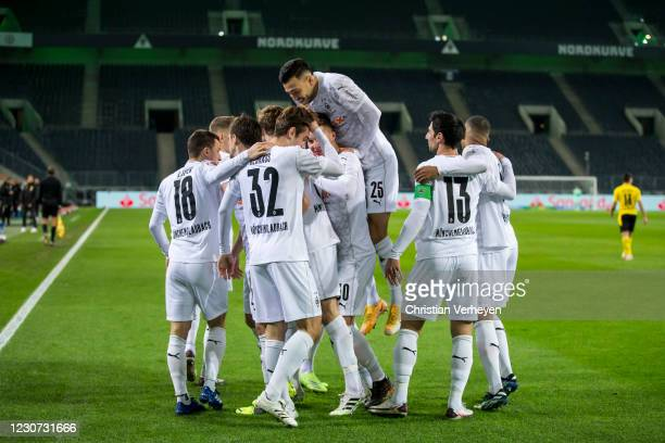 The Team of Borussia Moenchengladbach celebrates after Nico Elvedi scored his teams first goal during the Bundesliga match between Borussia...