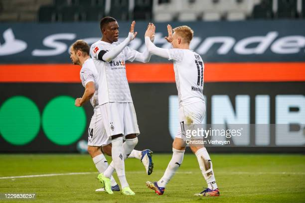 The Team of Borussia Moenchengladbach celebrates after Oscar Wendt scored his team's second goal during the Bundesliga match between Borussia...