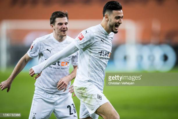 The Team of Borussia Moenchengladbach celebrates after Ramy Bensebaini scored his teams third goal during the Bundesliga match between Borussia...