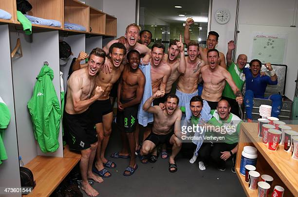 The team of Borussia Moenchengladbach celebrates after the match at the locker room during the Bundesliga match between SV Werder Bremen and Borussia...