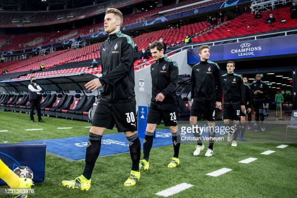 The Team of Borussia Moenchengladbach is seen before the UEFA Champions League Round Of 16 Leg One match between Borussia Moenchengladbach and...