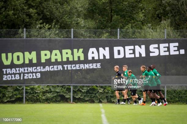 The Team of Borussia Moenchengladbach run during a Training Session at Borussia Moenchengladbach Training Camp at Stadion am Birkenmoos on July 23...