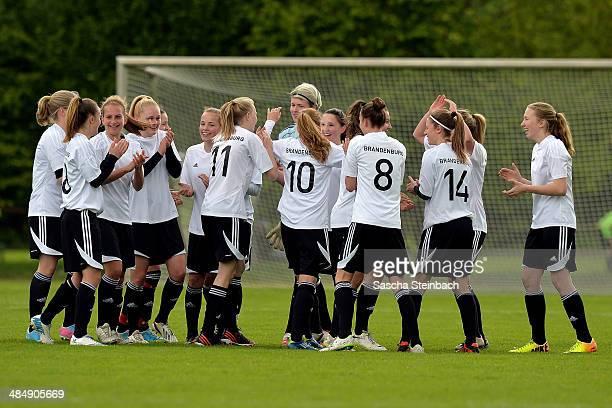 The team of Brandenburg celebrates after winning their U16 Girl's Federal Cup match against Niedersachsen at Sportschule Wedau on April 15 2014 in...