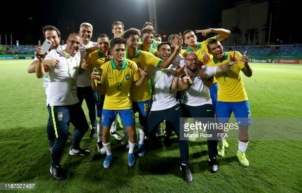 The team of Brazil celebrate after the FIFA U17 World Cup Brazil 2019 quarter final match between Italy and Brazil at Estadio Olimpico de Goias on...