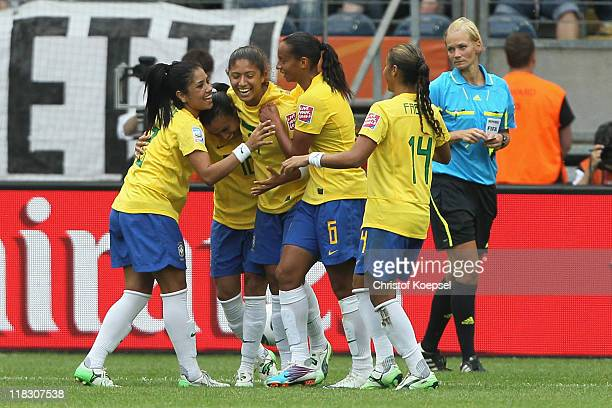 The team of Brazil celebrates the second goal of Cristiane of Brazil during the FIFA Women's World Cup 2011 Group D match between Equatorial Guinea...