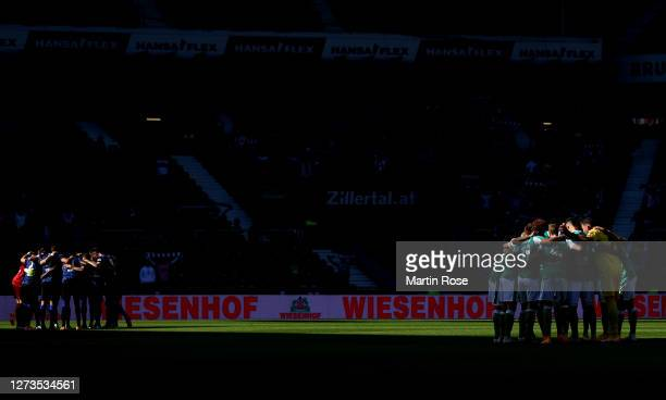 The team of Bremen and of Hertha BSC line up before the Bundesliga match between SV Werder Bremen and Hertha BSC at Wohninvest Weserstadion on...