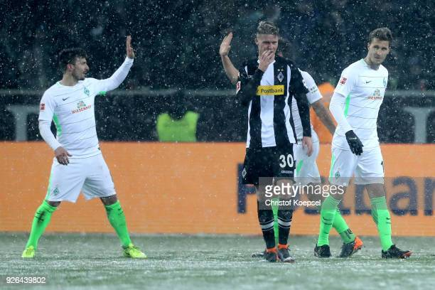 The team of Bremen celebrates and Nico Elvedi of Moenchengladbach looks dejected after the Bundesliga match between Borussia Moenchengladbach and SV...