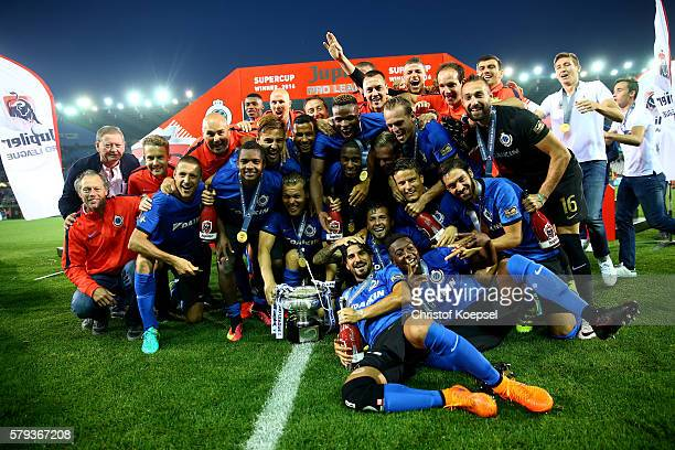 The team of Brugge celebrates with the trophy after winning 21 the Supercup match between Club Brugge and Standrad Liege at JanBreydelStadium on July...