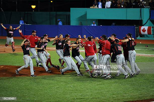 The team of Canada celebrates after the Baseball Gold Medal Match between the United States and Canada during Day 11 of the XVI Pan American Games at...