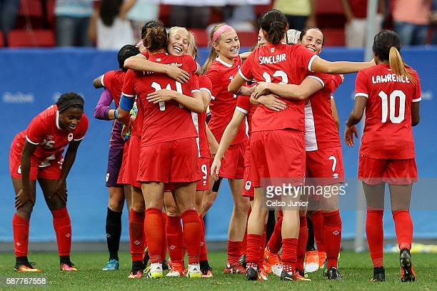 The team of Canada celebrates victory after the Women's First Round Group F match between Germany and Canada on Day 4 of the Rio 2016 Olympic Games...