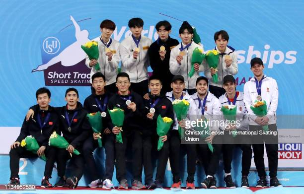 The team of China , the team of the Republic of Korea and the team of Hungary pose during the medal ceremony of the men 5000 meter relay final A of...