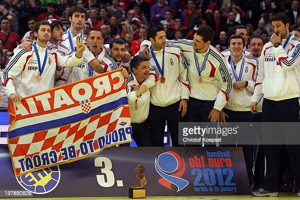 The team of Coratia poses for a team shot for the third place on the podium after the Men's European Handball Championship final match between Serbia...