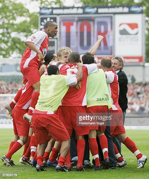 The team of Cottbus celebrates scoring the third goal during the Second Bundesliga match between Energie Cottbus and 1860 Munich at the Stadion der...