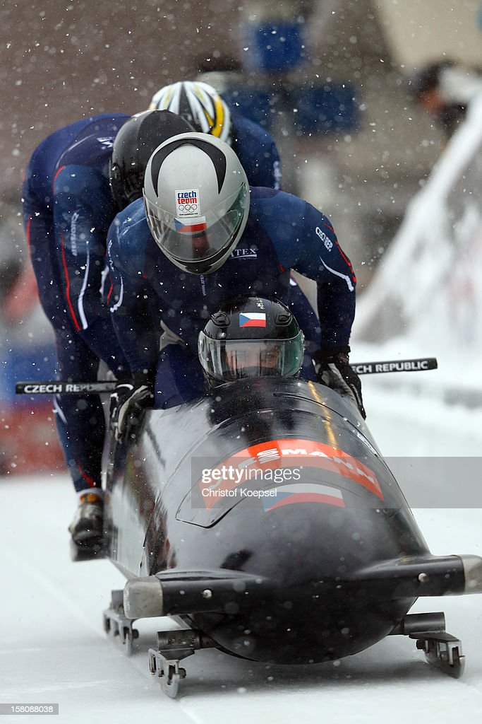 The team of Czech Republic 1 with Vladimir Hladik, Milos Vesely, Martin Bohman, Dominik Dvorak sprint during the four men's bob competition during the FIBT Bob & Skeleton World Cup at Bobbahn Winterberg on December 9, 2012 in Winterberg, Germany.