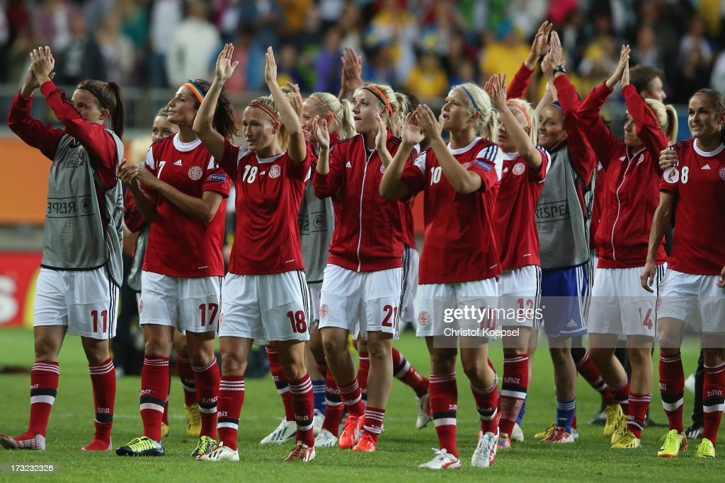 The team of Denmark celebrates after the 1-1 of daw of the UEFA Women's EURO 2013 Group A match between Sweden and Denmark at Gamla Ullevi Stadium on July 10, 2013 in Gothenburg, Sweden. The match between Sweden and Denmark ended 1-1.
