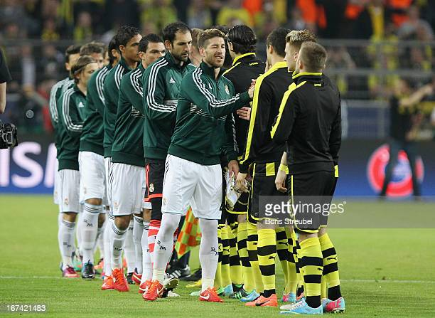 The team of Dortmund and Madrid shake hands prior to the UEFA Champions League semi final first leg match between Borussia Dortmund and Real Madrid...