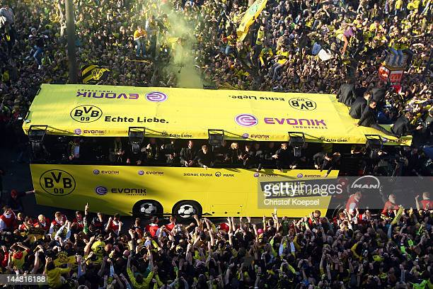 The team of Dortmund celebrate on the bus during a parade at Borsigplatz celebrating Borussia Dortmund's Bundesliga and DFB Cup win on May 13 2012 in...