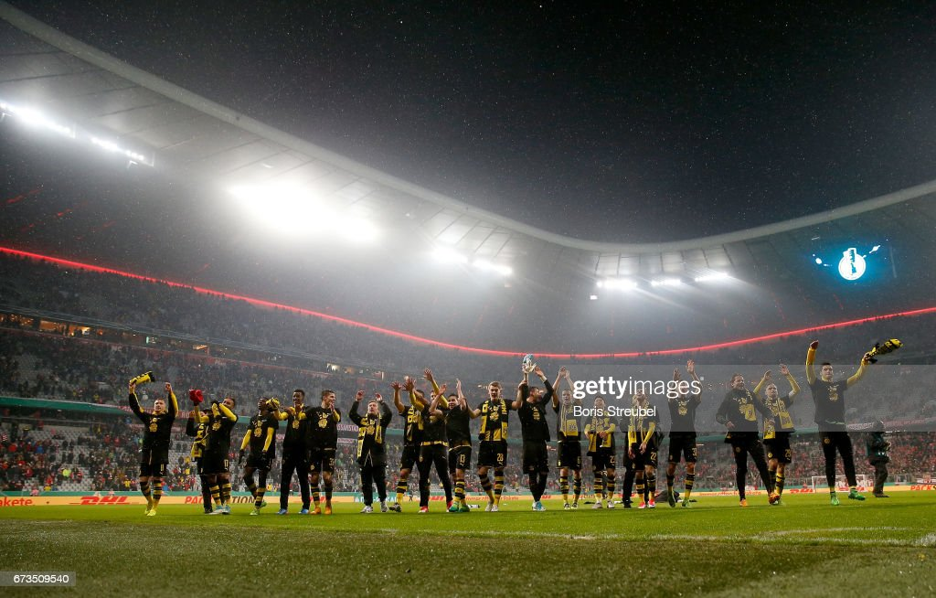 The team of Dortmund celebrate victory after the DFB Cup semi final match between FC Bayern Muenchen and Borussia Dortmund at Allianz Arena on April 26, 2017 in Munich, Germany.