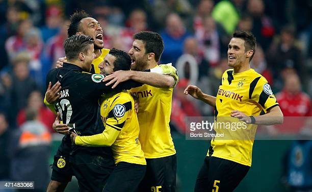 The team of Dortmund celebrate victory with their goalkeeper Mitchell Langerak after the DFB Cup semi final match between FC Bayern Muenchen and...