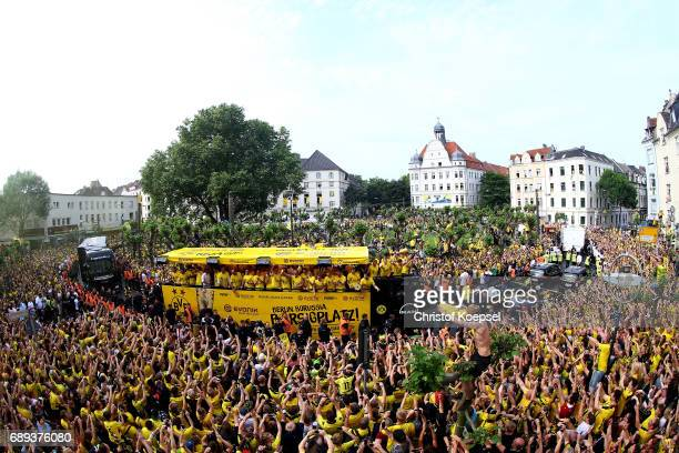 The team of Dortmund celebrates during a parade at Borsigplatz of Borussia Dortmund's DFB Cup win on May 28 2017 in Dortmund Germany