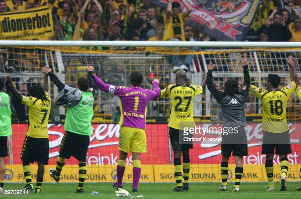 The team of Dortmund celebrates the 1-0 victory after the Bundesliga match between Borussia Dortmund and 1. FC Koeln at the Signal Iduna Park on...