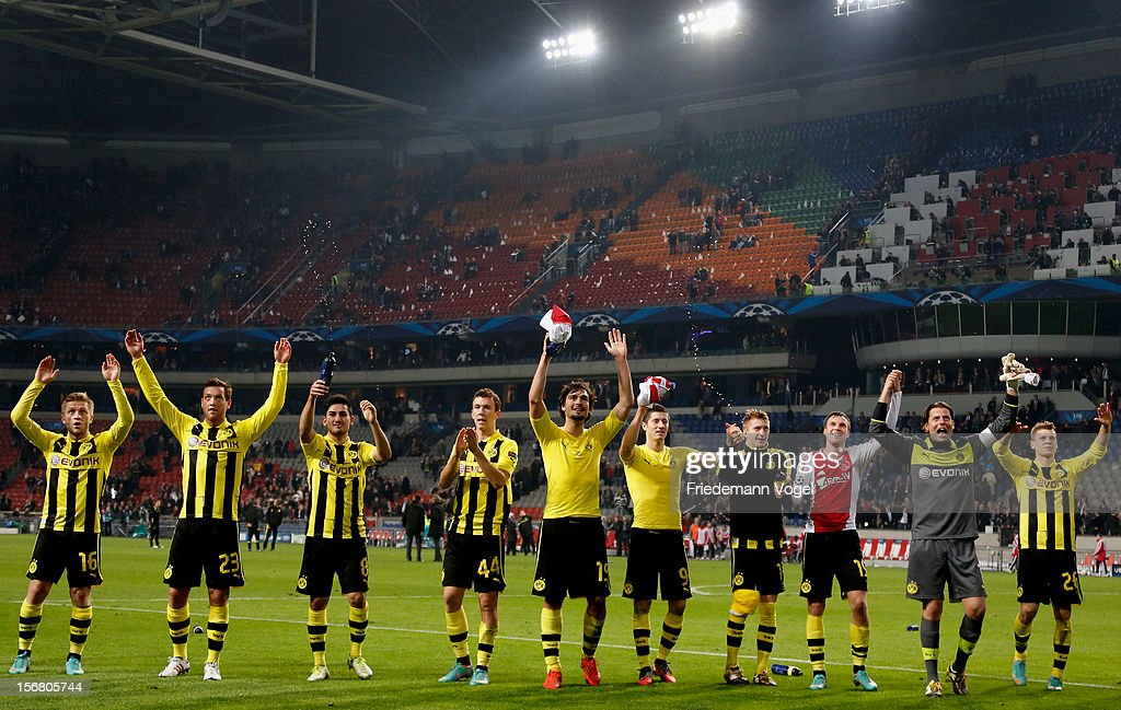 The team of Dortmund celebrates with the fans after the UEFA Champions League Group D match between Ajax Amsterdam and Borussia Dortmund at Amsterdam Arena on November 21, 2012 in Amsterdam, Netherlands.