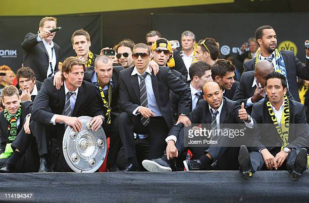 The team of Dortmund celebrates with the fans winning the German Championship at the Westfalenhalle on May 15 2011 in Dortmund Germany