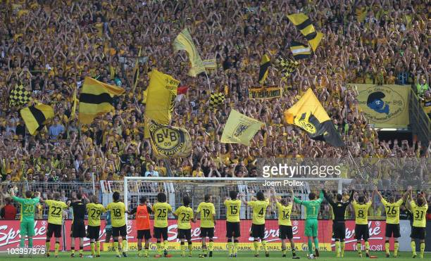 The team of Dortmund is celebrating with the fans after the Bundesliga match between Borussia Dortmund and VfL Wolfsburg at Signal Iduna Park on...