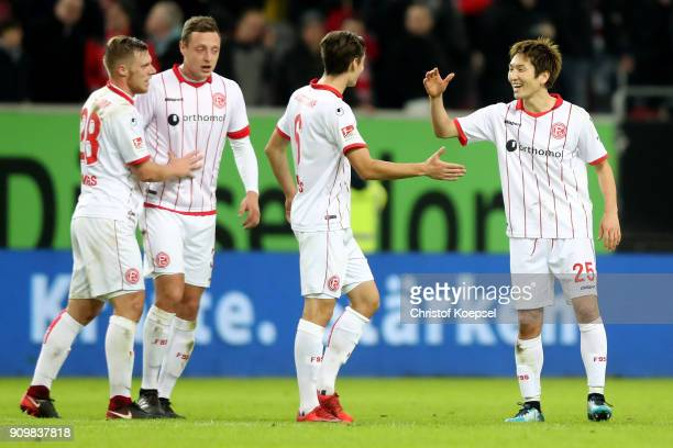 The team of Duesseldorf with Rouwen Hennings Robin Bormuth Florian Neuhaus and Genki Haraguchi celebrate after the Second Bundesliga match between...