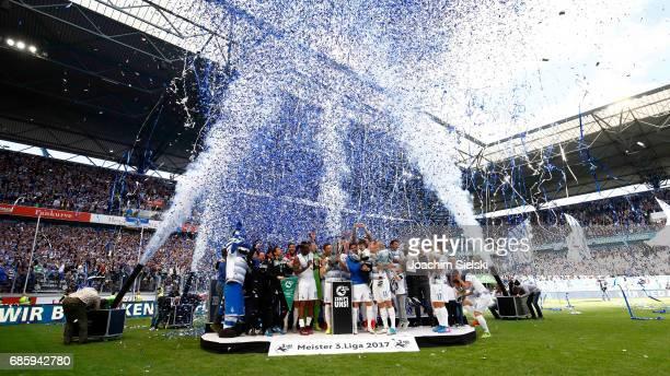 The team of Duisburg celebrate winning the Championship after the third league match between MSV Duisburg and FSV Zwickau at schauinsland reisen...