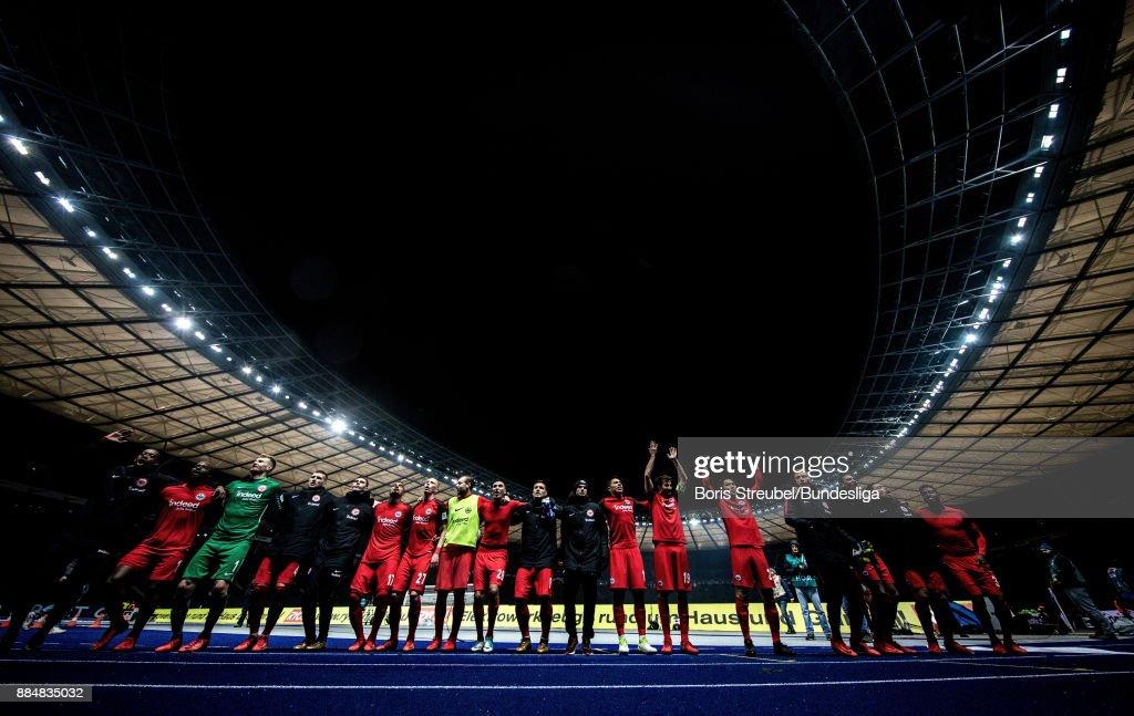 The team of Eintracht Frankfurt celebrate after winning the Bundesliga match between Hertha BSC and Eintracht Frankfurt at Olympiastadion on December 3, 2017 in Berlin, Germany.