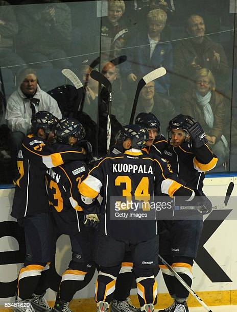 The team of Espoo Blues celebrates a goal during the IIHF Champions Hockey League match between Espoo Blues and HV71 Jonkoping on October 29, 2008 in...