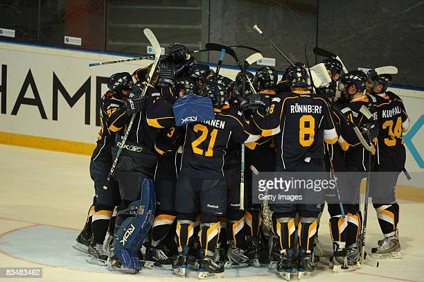 The team of Espoo Blues celebrates during the IIHF Champions Hockey League match between Espoo Blues and HV71 Jonkoping on October 29, 2008 in Espoo,...
