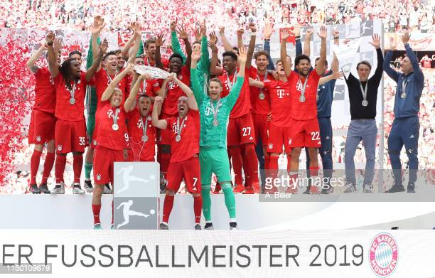 The team of FC Bayern celebrate the German Championship title after the Bundesliga match between FC Bayern Muenchen and Eintracht Frankfurt at...