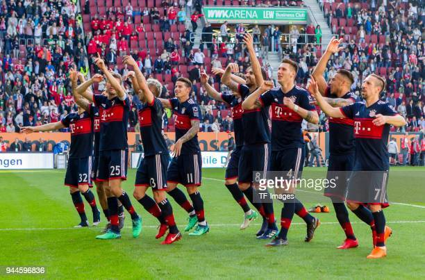 The team of FC Bayern Muenchen celebrates after winning the Bundesliga match between FC Augsburg and FC Bayern Muenchen at WWKArena on April 7 2018...